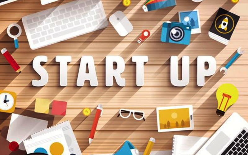 Start Up - Start Up Letters On Desk With Computer