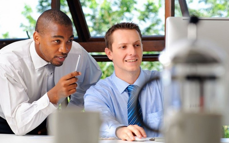 Best Mentor - Coworker Mentoring Other Coworker At Computer
