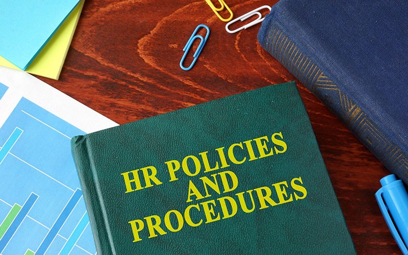 Best Policy - HR Policies and Procedures Book On Desk