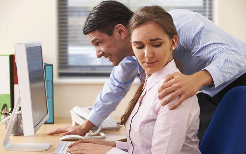 Sexual Harassment Prevention Training - Man With His Hand On Female Coworker's Shoulder
